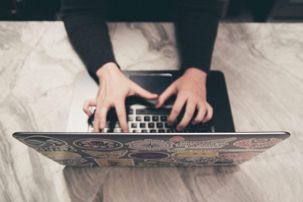 Laptop typing Photo